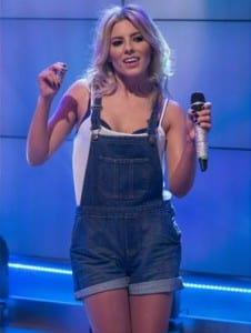 Mollie from The Saturdays in her denim short dungaree's