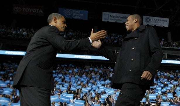U.S. President Barack Obama is greeted on stage by rapper Jay-Z at an election campaign rally in Columbus, Ohio, November 5, 2012 on the eve of the U.S. presidential elections. REUTERS/Jason Reed (UNITED STATES - Tags: POLITICS USA PRESIDENTIAL ELECTION ELECTIONS ENTERTAINMENT)
